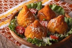 Arancini rice balls stuffed with meat and parmesan closeup. hori Royalty Free Stock Photo