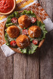 Arancini rice balls stuffed with meat and tomato sauce. vertical. Arancini rice balls stuffed with meat and tomato sauce on a table. vertical top view Royalty Free Stock Photo