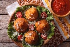 Arancini rice balls and tomato sauce closeup. horizontal top vie Royalty Free Stock Image