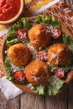 Arancini rice balls and tomato sauce closeup. vertical top view Royalty Free Stock Image