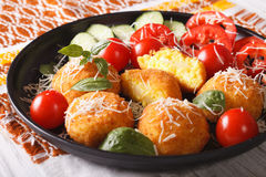 Arancini rice balls with vegetables close-up on a plate. Horizon. Fried arancini rice balls with vegetables close-up on a plate. Horizontal Stock Photography