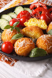 Arancini rice balls with vegetables close-up on a plate. vertica Royalty Free Stock Photo