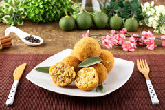 Arancini rice and meat. On complex background Royalty Free Stock Photo