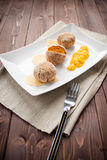Arancini rice and pumpkin. Fried rice balls with pumpkin cream on wood table Stock Image
