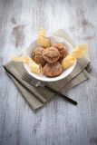 Arancini rice and pumpkin. Fried rice balls with pumpkin cream on wood table Royalty Free Stock Image