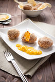 Arancini rice and pumpkin. Fried rice balls with pumpkin cream on wood table Royalty Free Stock Photo