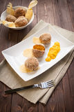 Arancini rice and pumpkin. Fried rice balls with pumpkin cream on wood table Royalty Free Stock Photography