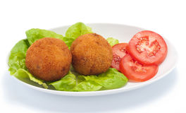 Arancini of rice with salad and tomato. On whine dish Stock Photo