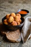 Arancini - traditional deep fried rice balls with meat and cheese. Arancini - traditional Italian deep fried rice balls with meat and cheese, served with tomato Royalty Free Stock Photo