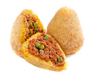 Arancini. Traditional Italian food of rice with fillings, covered with bread crumbs, and fried Stock Photo