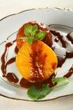 Arancio con caramella e miele Fotografia Stock