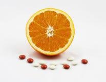Arancio con le vitamine ed i minerali Immagini Stock