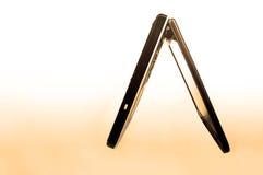 Arancio del computer portatile immagini stock libere da diritti