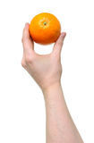 Arancio della holding della mano Fotografia Stock Libera da Diritti