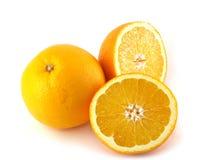 Arancio e due metà Fotografie Stock Libere da Diritti