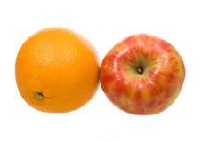 Arancio e mela Immagini Stock