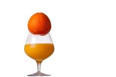 Arancio e un vetro di spremuta Fotografia Stock Libera da Diritti
