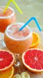 Arancio, pompelmo e smoothie delle banane Fotografia Stock