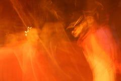Arancione astratto emette luce Immagini Stock Libere da Diritti