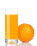 Arancione e vetro di spremuta fotografia stock libera da diritti