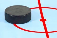 Arandela para el juego en hockey foto de archivo