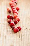Arandos maduros no fundo de madeira Fotografia de Stock