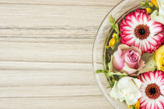 Arangement with roses and gerberas flowers in the glass bowl wit Stock Image