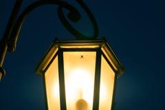 Aranha em um poste de luz Imagem de Stock