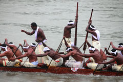 Aranmula Boat race. Oarsmen of a team wearing traditional dress participate at the Aranmula Boat race on September 14, 2011 in Aranmula, Kerala, India Royalty Free Stock Photography