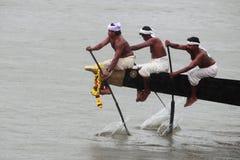 Aranmula Boat race. Oarsmen of a team wearing traditional dress participate at the Aranmula Boat race on September 14, 2011 in Aranmula, Kerala, India Stock Images