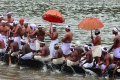 Aranmula Boat race. Oarsmen of a team wearing traditional dress participate at the Aranmula Boat race on September 14, 2011 in Aranmula, Kerala, India Stock Photo