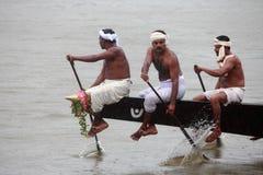 Aranmula Boat race. Oarsmen of a team wearing traditional dress participate at the Aranmula Boat race on September 14, 2011 in Aranmula, Kerala, India Royalty Free Stock Photo