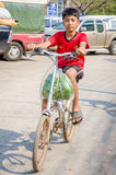 Aranyaprathet, Thailand : A boy cambodian riding. Boy cambodians ridind a bicycle in The Rong Kluea Market which is attached to the Cambodian border. At Stock Photo