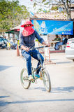 Aranyaprathet, Thailand : A man cambodian riding. Man cambodians ridind a bicycle in The Rong Kluea Market which is attached to the Cambodian border. At Royalty Free Stock Photo