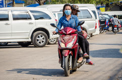 Aranyaprathet, Thailand : Womem cambodian riding. Women cambodians ridind a motorcycle in The Rong Kluea Market which is attached to the Cambodian border. At Stock Images