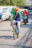 Aranyaprathet, Thailand : A women cambodian riding. Women cambodians ridind a bicycle in The Rong Kluea Market which is attached to the Cambodian border. At Stock Images