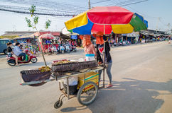 Aranyaprathet, Thailand : Women cambudian trolley. Two women cambodians pull cart at The Rong Kluea Market which is attached to the Cambodian border. At Royalty Free Stock Photo