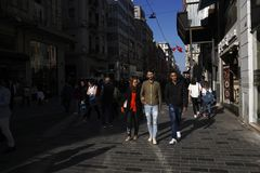 Arap ethnicity tourists are walking at The Istiklal Street Istanbul. Istanbul, Turkey - April 19, 2018: Arap ethnicity tourists are walking at The Istiklal Royalty Free Stock Photography