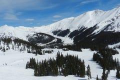 Arapahoe Basin Blue Bird Day: View Toward Loveland Pass. Arapahoe Basin Blue Bird Day: Snowboarder & Montezuma Bowl, Summit County, near Dillon, and Silverthorne stock images