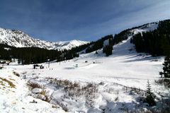 Arapahoe Basin Ski Resort. A view of of the slopes at Arapahoe Basin Ski Resort. Arapahoe Basin (A-Basin) is a popular ski area for alpine skiing high in White Royalty Free Stock Image