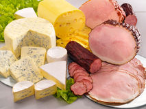 Ararangement with cheese, ham and sausage. On table Stock Photo