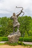 Arash the Archer statue in park. Statue of Arash Kamangir the Archer in the Niavaran Palace Complex garden, is a heroic archer-figure of Iranian folktale Royalty Free Stock Image