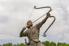 Arash the Archer tightens arrow. Statue of Arash Kamangir the Archer in the Niavaran Palace Complex garden, is a heroic archer-figure of Iranian oral tradition Royalty Free Stock Images