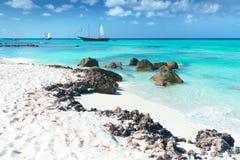 Arashi Beach Aruba Caribbean Sea sand rocks crystal clear turquoise water boats. Arashi Beach, Aruba, Caribbean Sea: 2 tour boats anchored for tourists to go Stock Photo