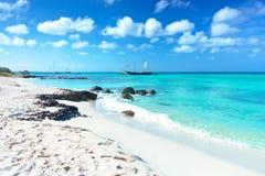Arashi Beach Aruba Caribbean Sea sand rocks crystal clear turquoise water boats. Arashi Beach, Aruba, Caribbean Sea: tour boat anchored near the shore for Stock Image