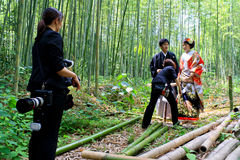 Arashiyama Bamboo Forest. Newlyweds have their nuptial photos taken in Kyoto`s Arashiyama Bamboo Forest. This particular forest is one of Kyoto`s most popular Royalty Free Stock Image