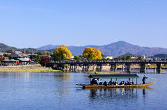 Arashiyama and a bridge in Kyoto Japan. Seasonal picture of clear autumn sky and wooden bridge at Arashiyama district in Kyoto Japan autumn Royalty Free Stock Photography
