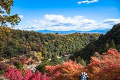 Arashiyama. Colorful of maple forest on the mountain at autumn season in Arashiyama, Kyoto, Japan. From observation view point at Senkoji temple, over hozu river stock images