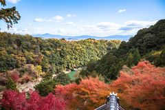Arashiyama. Colorful of maple forest on the mountain at autumn season in Arashiyama, Kyoto, Japan. From observation view point at Senkoji temple, over hozu river stock photography