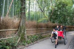 Traditional Japanese hand pulled rickshaw in Arashiyama royalty free stock image